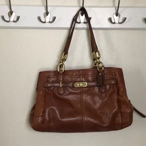 Tan leather Coach bag. Used with obvious wear